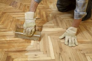 Make sure to properly maintain your hardwood flooring by moving furnitures around - allowing it to age evenly.