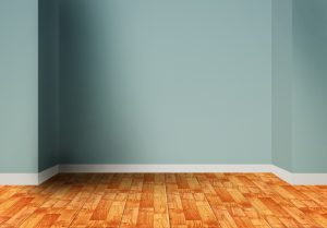 Empty room interior with blue wall and wooden floor
