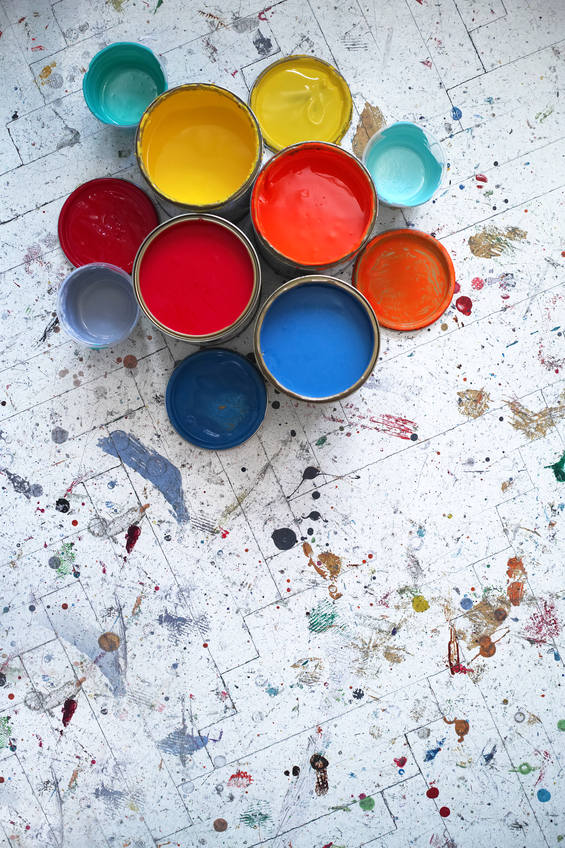 Different Size And Colour Paint Cans With Paint Splashed Floor