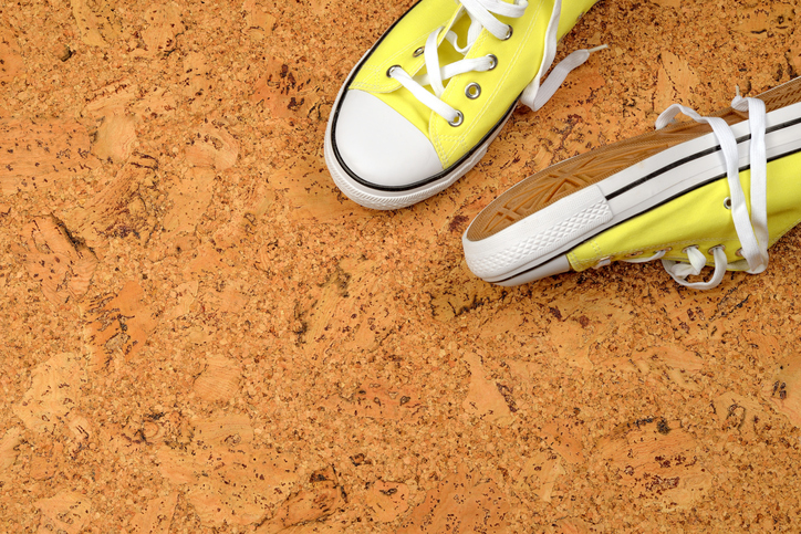 yellow sneakers on a background of cork
