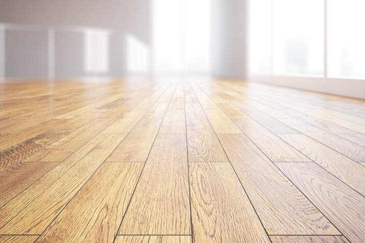 Closeup of light wooden floor in bright room interior. 3D Rendering