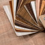 Veneer packs contain samples of blackwood on desk