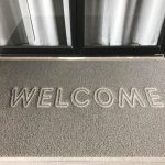 Welcome wording on gray grunge door mat