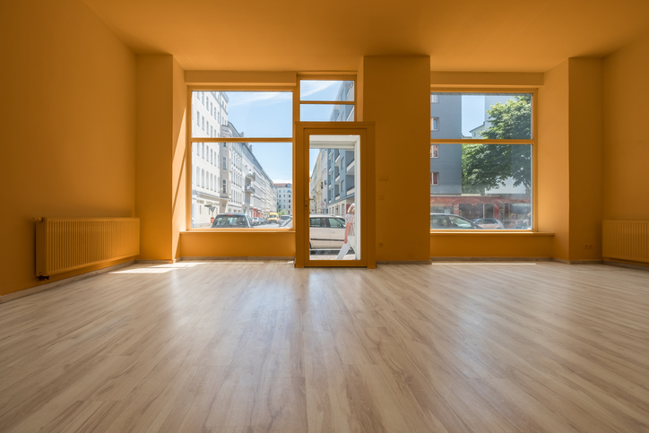 renovated showroom / shop - empty room with wooden floor and shopping window