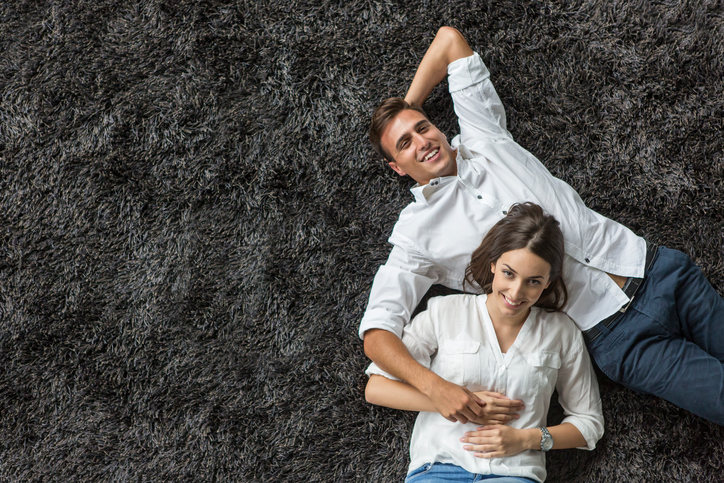 Young couple relaxing on the carpet