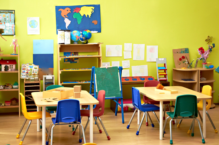 Colorful preschool tables with chairs and things for education